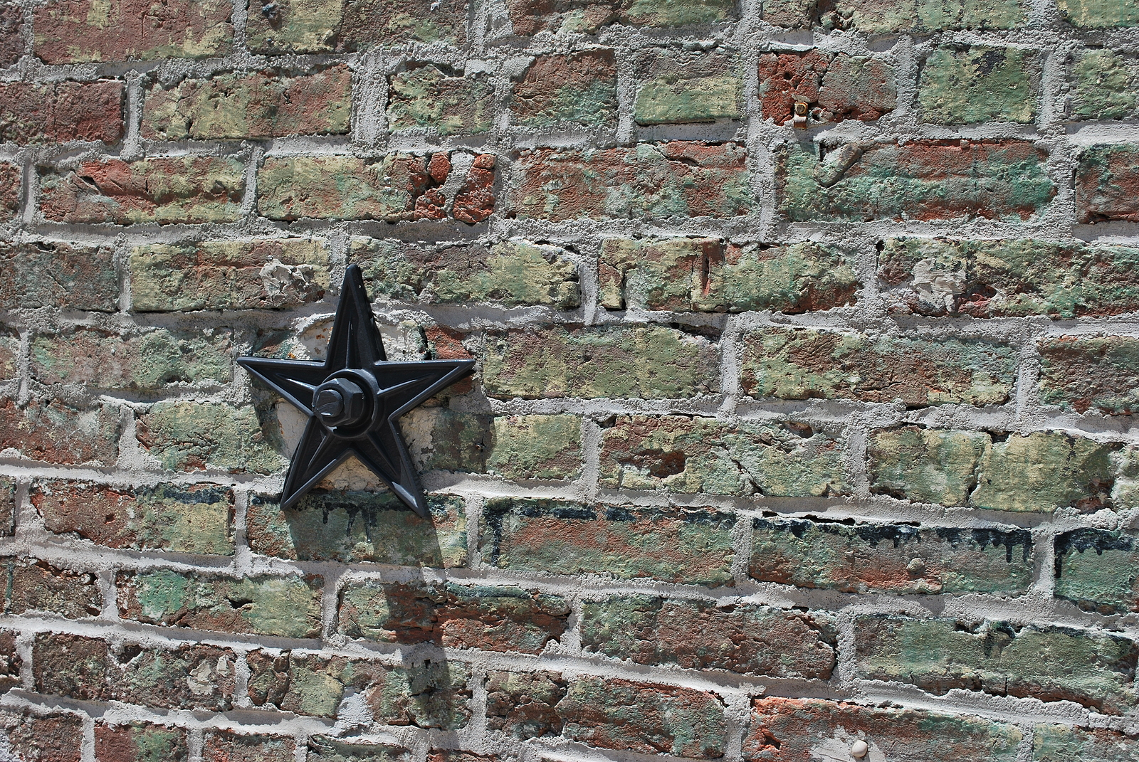 Star-tie-rod-stabilizes-old-tuckpointed-wall-renaissance-development-dc
